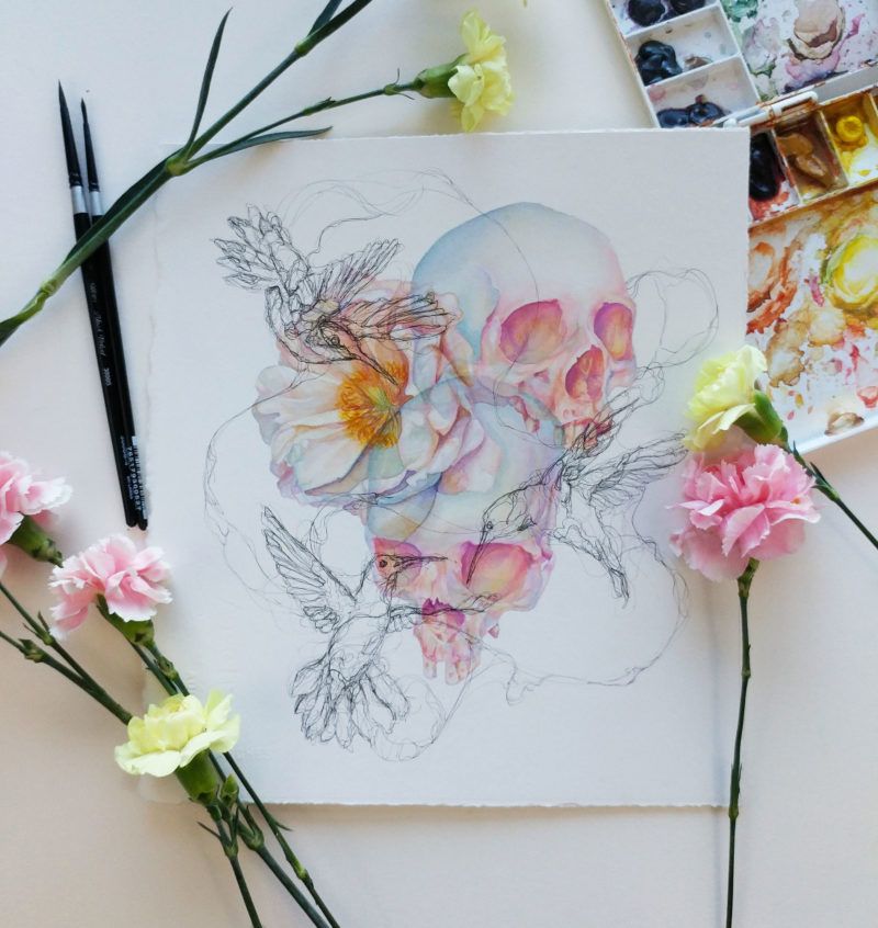 Watercolor painting of skulls and a peony with ink hummingbirds.
