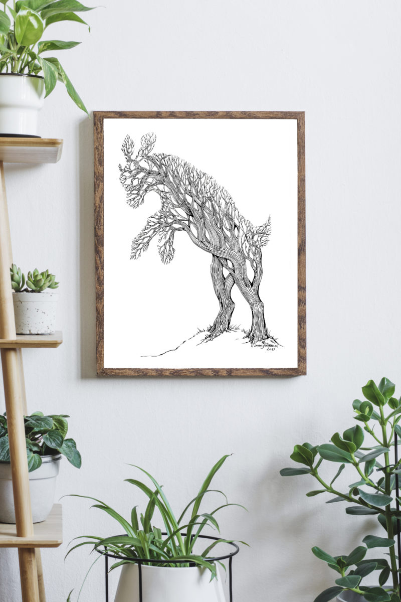 Mockup of the Capering Forest in a wood frame on a wall with plants